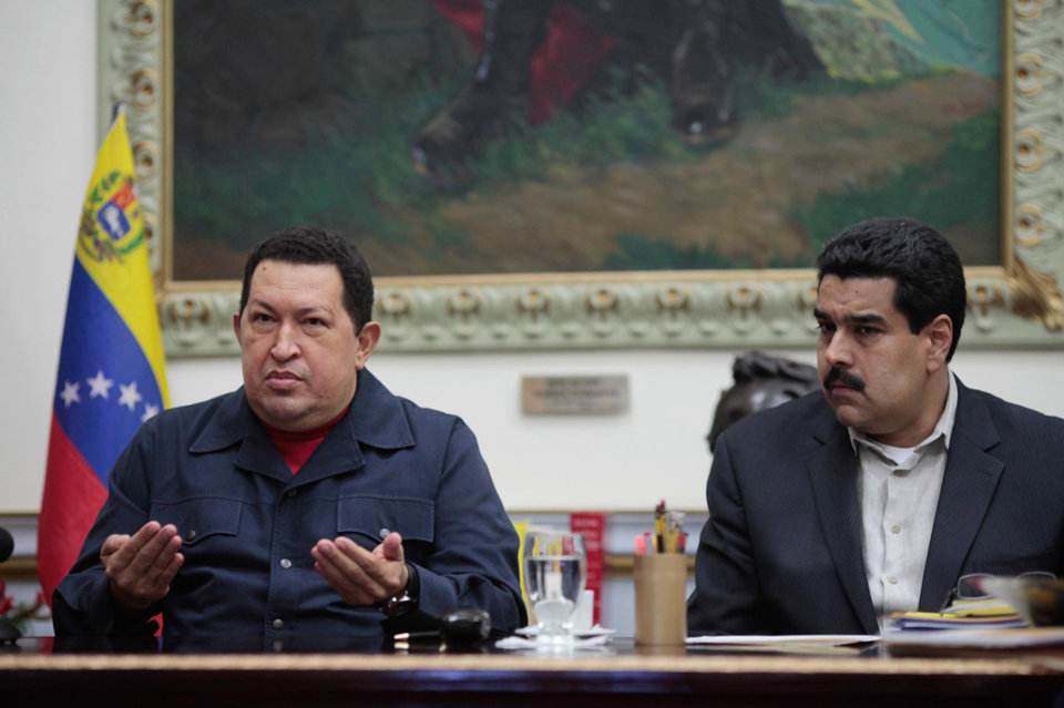 Photo - In this photo released by Miraflores Press Office, Venezuela's President Hugo Chavez , left, speaks beside his Vice-President Nicolas during a televised speech form his office at Miraflores Presidential palace in Caracas, Venezuela, Saturday, Dec. 8, 2012. Chavez announced Saturday night that his cancer has returned and that he will undergo another surgery in Cuba. Chavez, who won re-election on Oct. 7, also said for the first time that if his health were to worsen, his successor would be Vice President Nicolas Maduro.(AP Photo/Miraflores Press Office, Marcelo Garcia)
