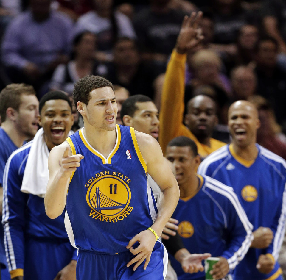 Photo - Golden State Warriors' Klay Thompson (11) celebrates a basket against the San Antonio Spurs during the first half in Game 2 of their Western Conference semifinal NBA basketball playoff series, Wednesday, May 8, 2013, in San Antonio. (AP Photo/Eric Gay)