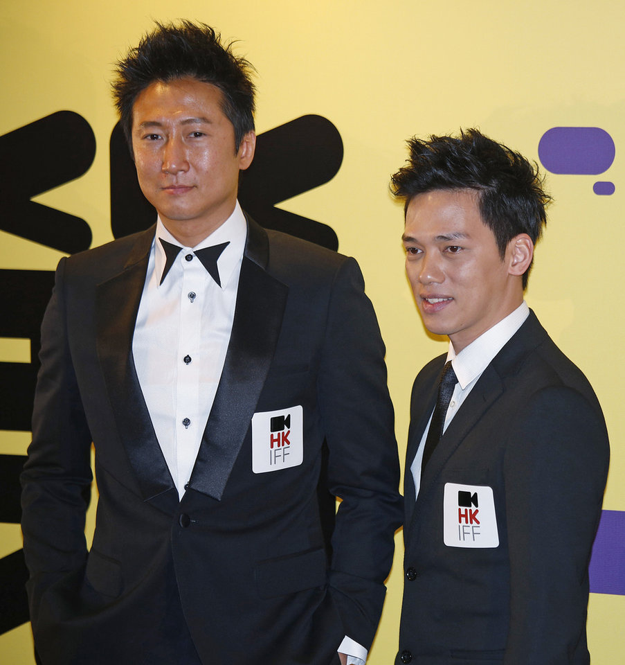 Photo - Hong Kong actor Timmy Hung, left, and Marvel Chow pose for photographers at the red carpet of 37th Hong Kong International Film Festival (HKIFF) Grand Opening in Hong Kong Sunday, March 17, 2013. (AP Photo/Vincent Yu)