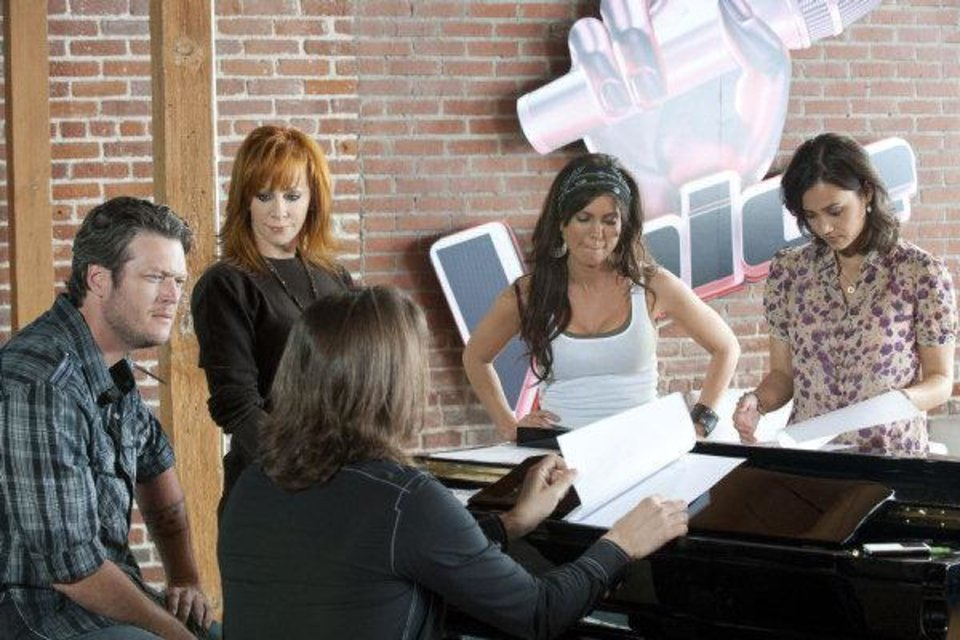 Photo - From left, Oklahoma country music stars Blake Shelton and Reba McEntire work with