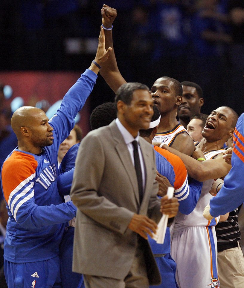 Oklahoma City\'s Derek Fisher (37), left, and Russell Westbrook (0), right, celebrate with Kevin Durant (35) and other Thunder players after game one of the first round in the NBA playoffs between the Oklahoma City Thunder and the Dallas Mavericks at Chesapeake Energy Arena in Oklahoma City, Saturday, April 28, 2012. Durant hit the game-winning shot. Oklahoma City won, 99-98. At front is Oklahoma City assistant coach Maurice Cheeks. Photo by Nate Billings, The Oklahoman