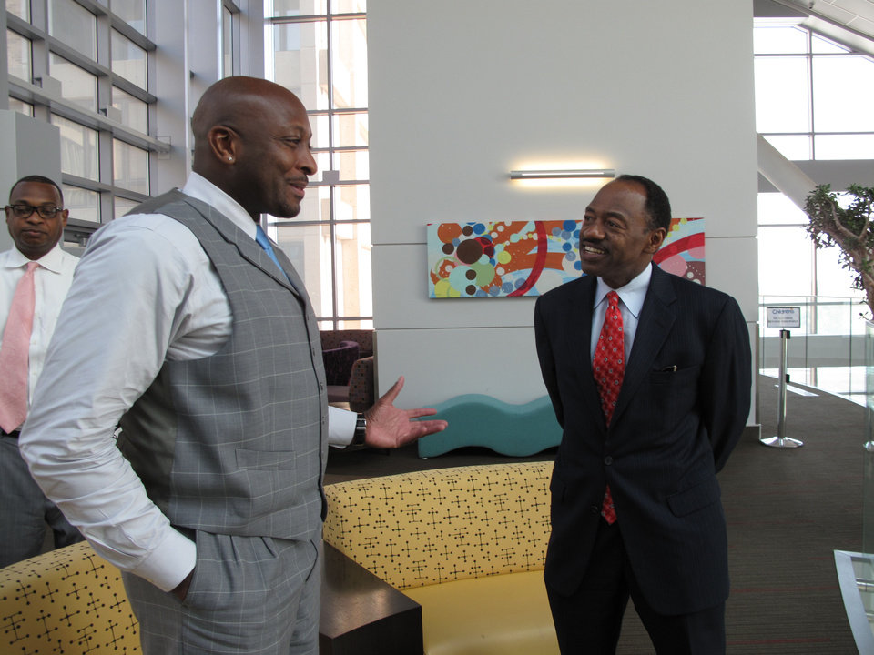 Earl Martin Phalen, CEO of Reach Out and Read, talks with Judge David E. Lewis with the Oklahoma Court of Criminal Appeals, prior to a reception held in Phalen's honor at Children's Hospital in Oklahoma City. <strong>CARLA HINTON - CARLA HINTON</strong>