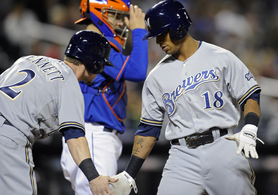 Photo - Milwaukee Brewers' Khris Davis, right, celebrates with Scooter Gennett after Davis hit a two-run home run during the first inning of a baseball game against the New York Mets Friday, Sept. 27, 2013, in New York. (AP Photo/Bill Kostroun)