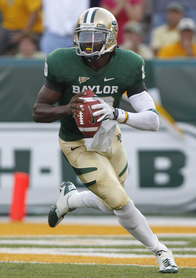 FOR USE AS DESIRED WITH NFL DRAFT STORIES - FILE - In this Sept. 2, 2011, file photo, Baylor quarterback Robert Griffin III (10) looks to pass during the first half of the NCAA college football game against TCU in Waco, Texas. Griffin is a top prospect in the upcoming NFL football draft.(AP Photo/LM Otero, File)