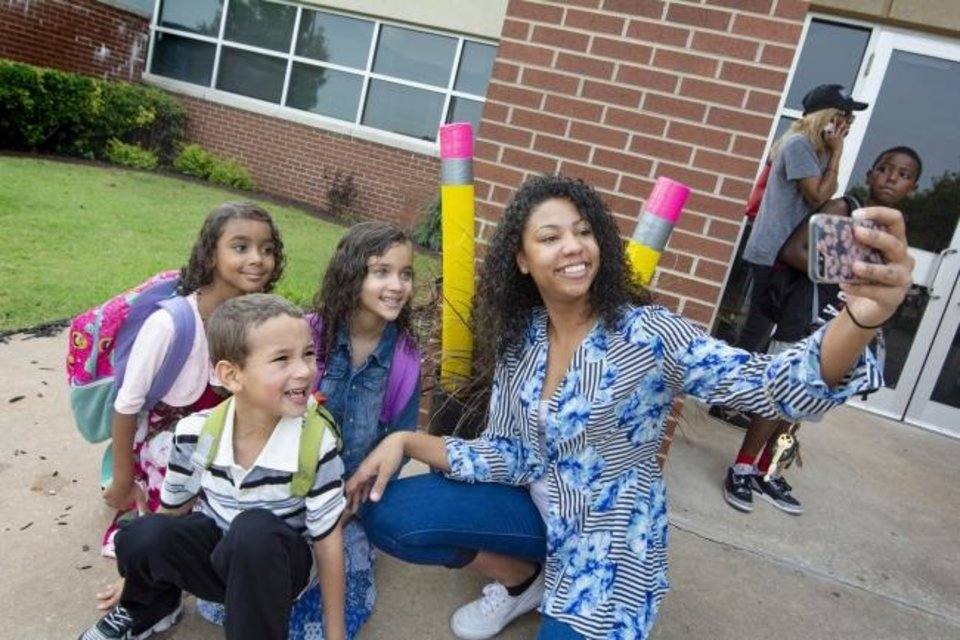 Photo -  Jessica Duncan takes a selfie with her children on their first day back to school at Angie Debo Elementary in 2018. [The Oklahoman Archives]