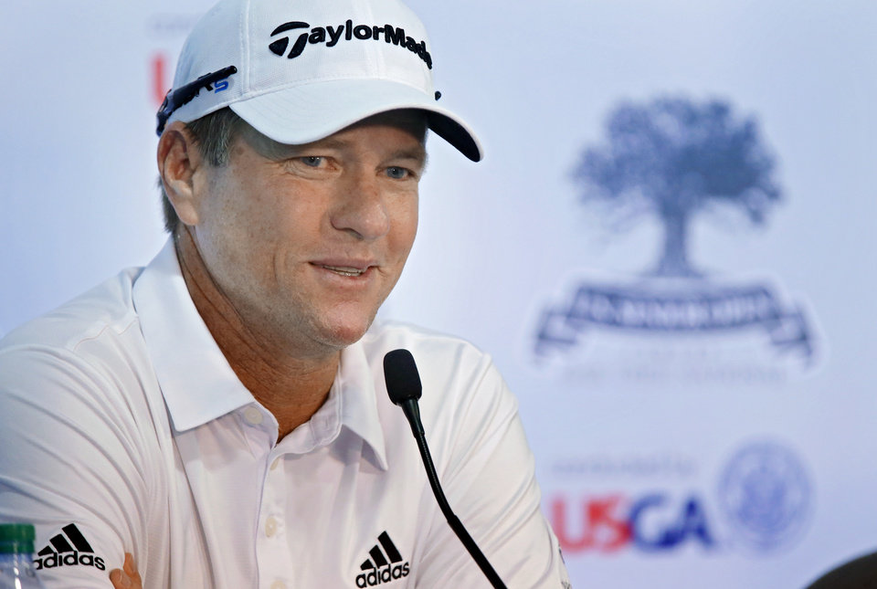 Photo - Scott Verplank speaks during a press conference for the U.S. Senior Open golf tournament at Oak Tree National in Edmond, Okla. on Tuesday, July 8, 2014. Photo by Chris Landsberger, The Oklahoman