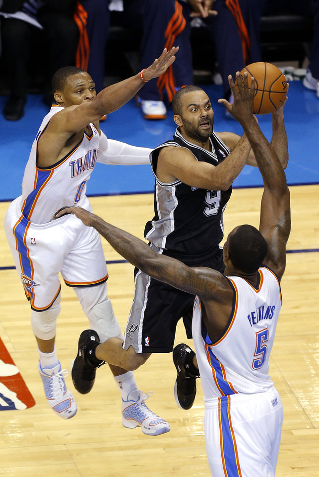 Photo - San Antonio's Tony Parker (9) goes to the basket as Oklahoma City's Russell Westbrook (0) and Kendrick Perkins (5) defend during Game 4 of the Western Conference Finals in the NBA playoffs between the Oklahoma City Thunder and the San Antonio Spurs at Chesapeake Energy Arena in Oklahoma City, Tuesday, May 27, 2014. Photo by Bryan Terry, The Oklahoman