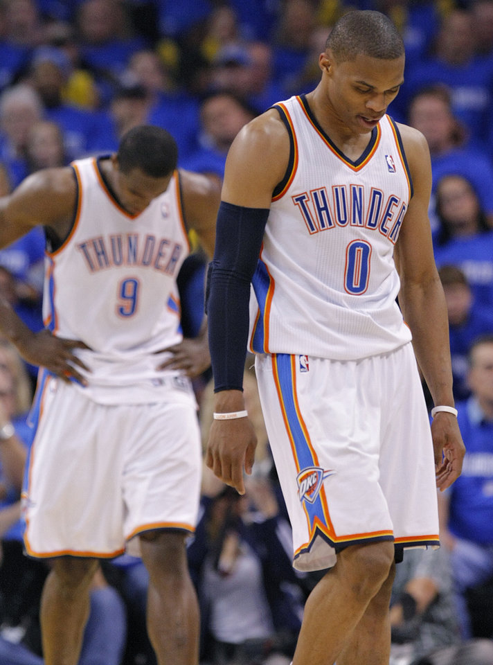 Oklahoma City\'s Russell Westbrook (0) and Serge Ibaka (9) hang their heads as they walk off the court late in the fourth quarter of the 114-101 loss to Memphis during game one of the Western Conference semifinals between the Memphis Grizzlies and the Oklahoma City Thunder in the NBA basketball playoffs at Oklahoma City Arena in Oklahoma City, Sunday, May 1, 2011. Photo by Chris Landsberger, The Oklahoman