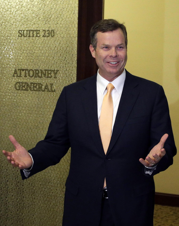 Photo - FILE - In this June 19, 2013, file photo, Utah Attorney General John Swallow addresses reporters outside his office at the Utah State Capitol, in Salt Lake City. The cost of the ongoing Utah House investigation of the state's attorney general is nearing $1.5 million. The Salt Lake Tribune reports Republican Rep. Jim Dunnigan said Wednesday, Nov. 20, 2013, that investigators have talked with 140 witnesses and issued 15 subpoenas during the first three months of the inquiry into a series of allegations against John Swallow. He's accused of attempted bribery and accepting gifts and favors among other accusations. Swallow denies any wrongdoing. (AP Photo/Rick Bowmer, File)