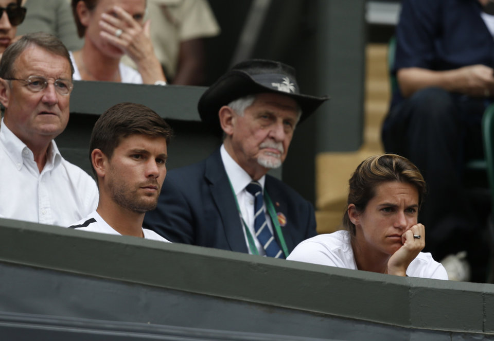 Photo - Coach of Andy Murray of Britain Amelie Mauresmo, right, watches Murray's first round match against David Goffin of Belgium at the All England Lawn Tennis Championships in Wimbledon, London,  Monday, June  23, 2014. (AP Photo/Pavel Golovkin)