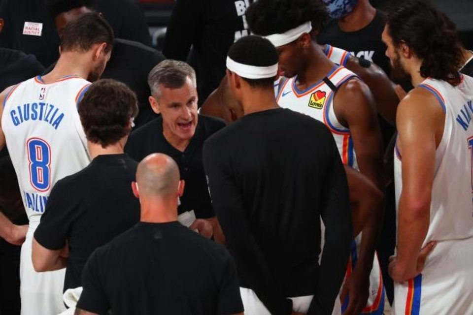 Photo -  Thunder coach Billy Donovan, whose contract expires at the end of this season, huddles with his players during the second half of Game 7 Wednesday. [Kim Klement/USA TODAY Sports]