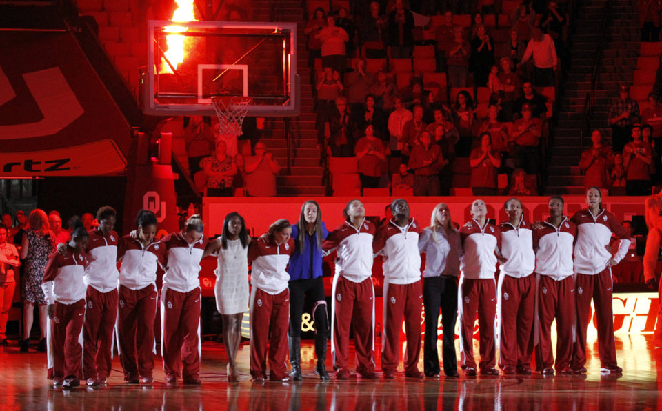 Photo - The women's team stands in line as players are introduced as the University of Oklahoma Sooners (OU) play the Kansas Jayhawks in NCAA, women's college basketball at The Lloyd Noble Center on Saturday, Feb. 22, 2014  in Norman, Okla.  Aaryn Ellenberg is in street clothes fifth from left.   Photo by Steve Sisney, The Oklahoman