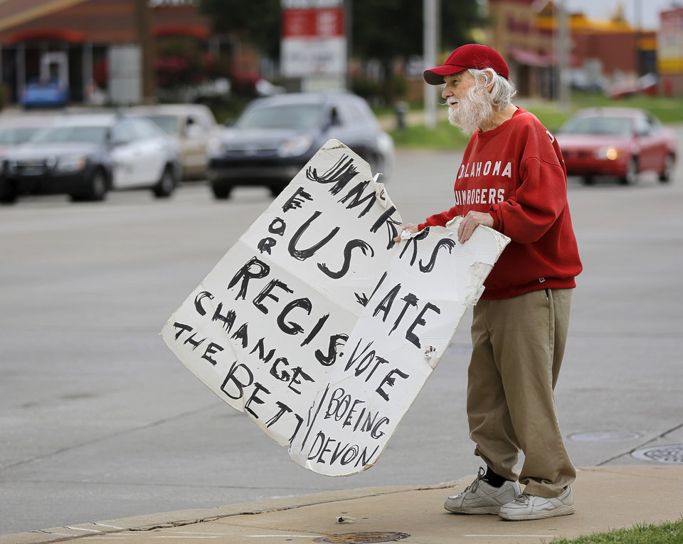 Photo -  U.S. Senate candidate Jim Rogers campaigns June 26 on a street corner in Midwest City. Photo by Jim Beckel, The Oklahoman   Jim Beckel -