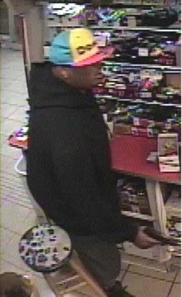 Photo - This is a photograph released by police of a man wanted for questioning in the July 23 homicide of store clerk Habib Hajimirzaei, 62, at 4 Seasons  Gas & Food store, 13 NW 63.   - photo provided