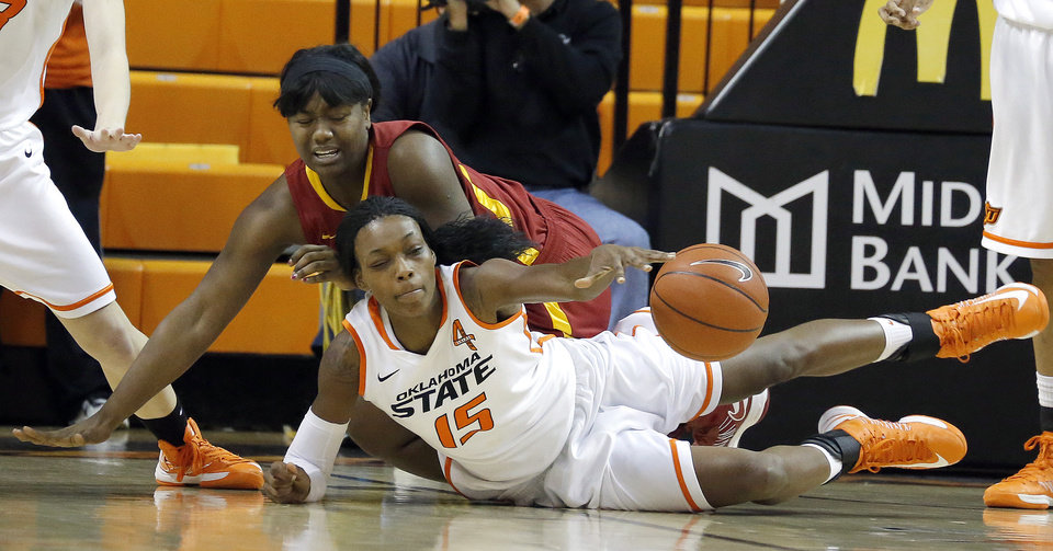 Photo - Oklahoma State's Toni Young (15) and Iowa State's Fallon Ellis (32) dive for a loose ball during the women's college basketball game between Oklahoma State and Iowa State at  Gallagher-Iba Arena in Stillwater, Okla.,  Sunday,Jan. 20, 2013.  OSU won 71-42. Photo by Sarah Phipps, The Oklahoman