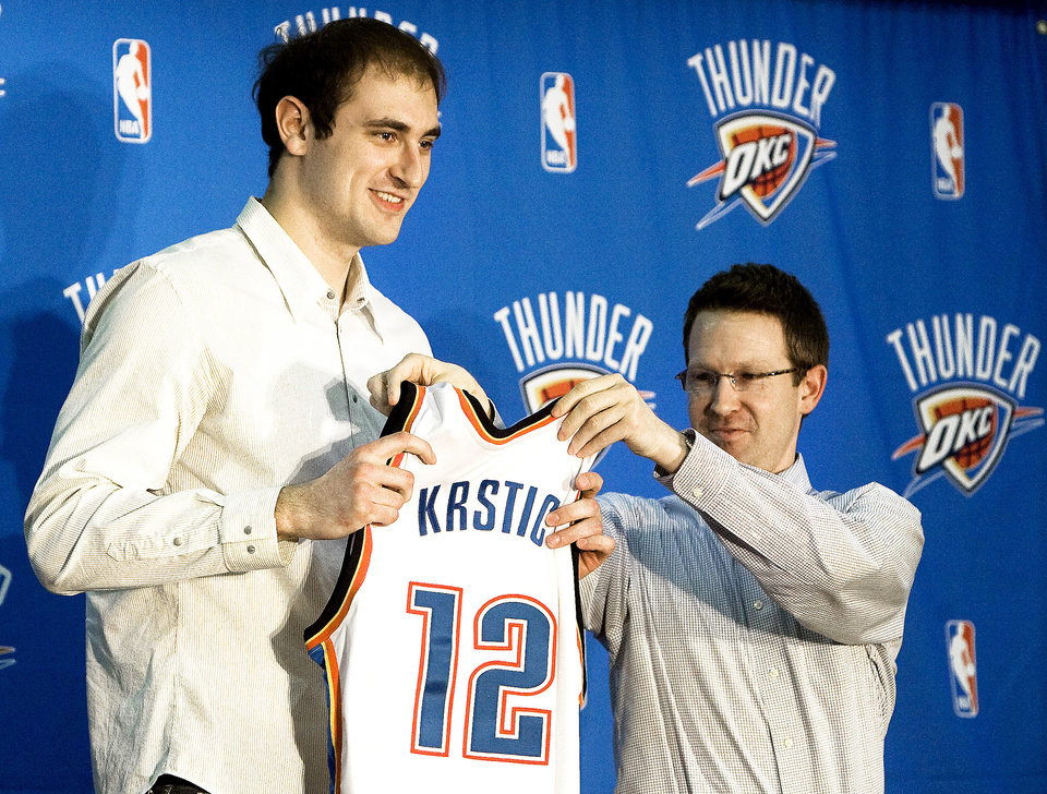 Sam Presti, right, finally got his man, Nenad Krstic.PHOTO BY SARAH PHIPPS, THE OKLAHOMAN