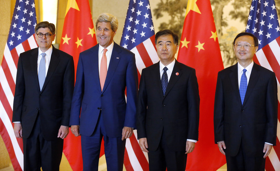 Photo - U.S. Treasury Secretary Jack Lew, left, U.S. Secretary of State John Kerry, second left, China's Vice Premier Wang Yang, third left,  and State Councilor Yang Jiechi pose together before a working lunch at the U.S.-China Strategic and Economic Dialogue, at the Diaoyutai State Guesthouse in Beijing Wednesday, July 9, 2014. (AP Photo/Jim Bourg, Pool)