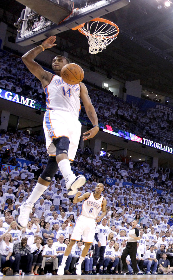 Photo - Oklahoma City's Daequan Cook (14) dunks during game five of the Western Conference semifinals between the Memphis Grizzlies and the Oklahoma City Thunder in the NBA basketball playoffs at Oklahoma City Arena in Oklahoma City, Wednesday, May 11, 2011. Photo by Sarah Phipps, The Oklahoman