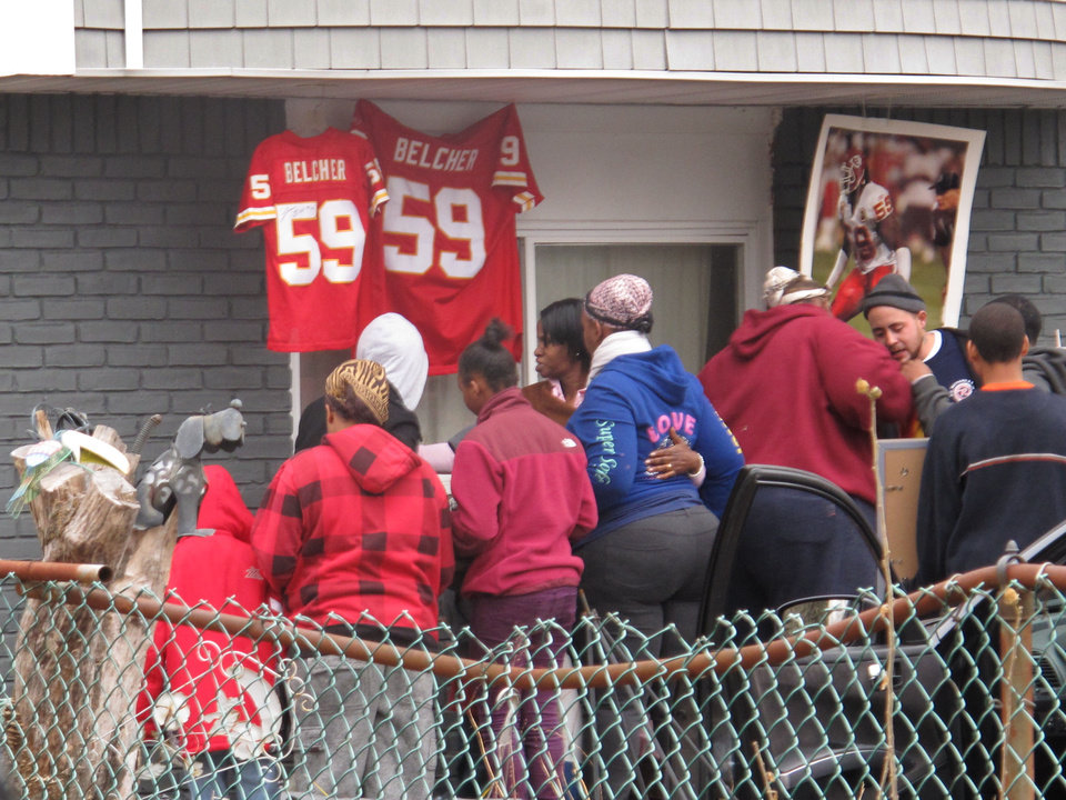 Friends and relatives of Kansas City Chiefs linebacker Jovan Belcher grieve outside the player\'s home on Dec. 1, 2012, in West Babylon, N.Y. Police said the Long Island native shot and killed his girlfriend before taking his own life on Saturday in Kansas City. (AP Photo/Frank Eltman)