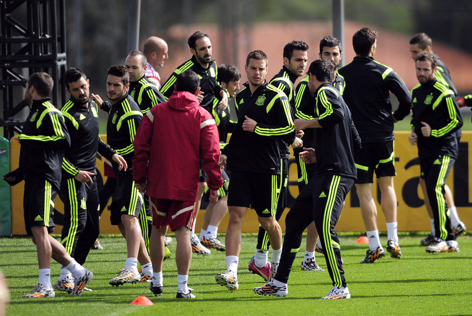 Photo - Spain's players attend an official training session the day before the group B World Cup soccer match between Spain and Australia at the Atletico Paranaense training center in Curitiba, Brazil, Sunday, June 22, 2014. Spain will play in group B of the Brazil 2014 World Cup. (AP Photo/Manu Fernandez)