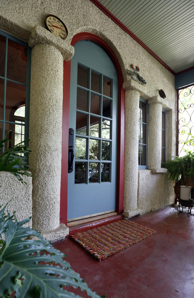 Photo - This porch entry originally was a courtyard in front of the 1921 Spanish Revival-style home of Michael Brinkley and Lynda Donley in Norman.  STEVE SISNEY -  THE OKLAHOMAN