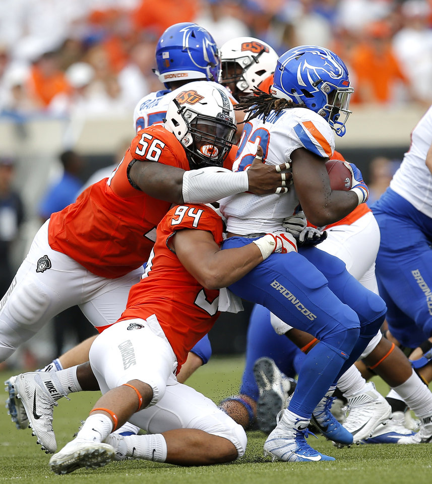 Photo - Oklahoma State's Enoch Smith Jr. (56) and Jordan Brailford (94) tackle Boise State's Alexander Mattison (22) in the third quarter during a college football game between the Oklahoma State Cowboys (OSU) and the Boise State Broncos at Boone Pickens Stadium in Stillwater, Okla., Saturday, Sept. 15, 2018. OSU won 44-21. Photo by Sarah Phipps, The Oklahoman