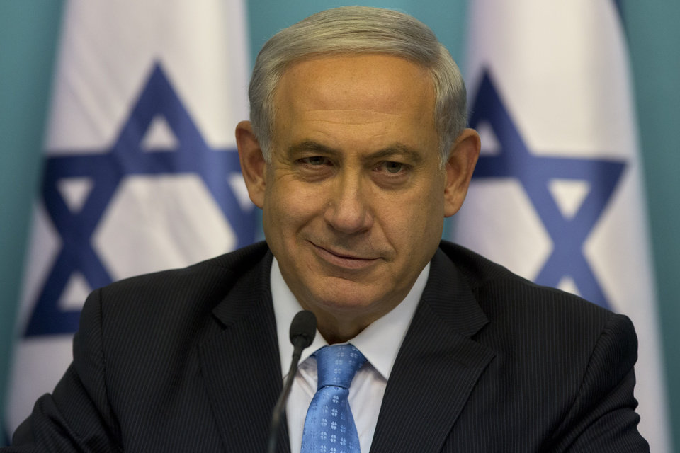 Photo - Israeli Prime Minister Benjamin Netanyahu smiles during a press conference at the prime minister's office in Jerusalem, Wednesday, Aug. 27, 2014.  Israel's prime minister declared victory Wednesday in the recent war against Hamas in the Gaza Strip, saying the military campaign had dealt a heavy blow and a cease-fire deal gave no concessions to the Islamic militant group.(AP Photo/Sebastian Scheiner)