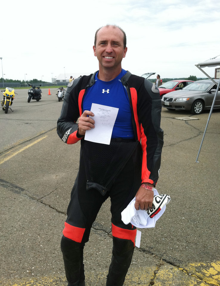 In this July 2011 photo, Bill Warner poses for a photo during the Maine Event. Warner died Sunday, July 14, 2013, after losing control and zooming off a runway during the Maine Event at a former U.S. air base at Limestone, Maine. Warner, 44, was clocked at 285 mph before he lost control, said Tim Kelly, race director for the Loring Timing Association. (AP Photo/Linda Kelly)  NO SALES