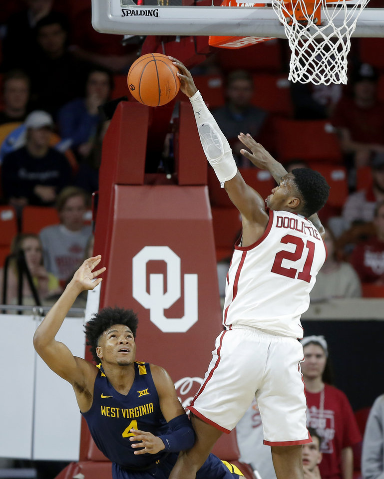 Photo - Oklahoma's Kristian Doolittle (21) blocks the shot of West Virginia's Miles McBride (4) during an NCAA mens college basketball game between the University of Oklahoma Sooners (OU) and the West Virginia Mountaineers at the Lloyd Noble Center in Norman, Okla.,Saturday, Feb. 8, 2020. Oklahoma won 69-59. [Bryan Terry/The Oklahoman]