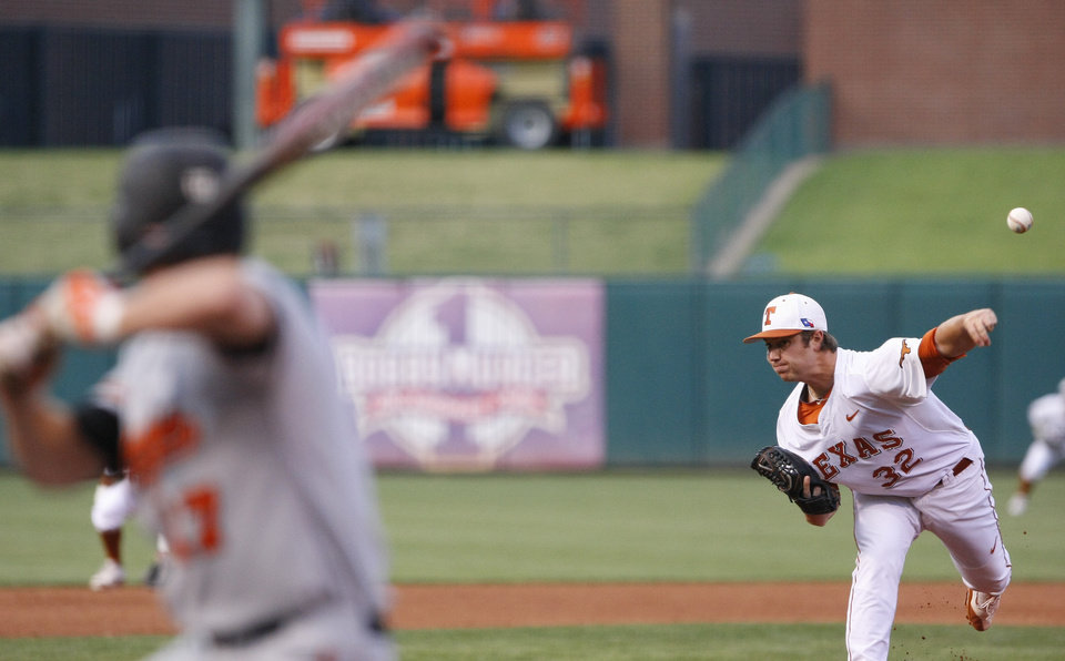 Photo - Texas starting pitcher Dillon Peters throws in the first inning of a second-round game against Oklahoma State in the Big 12 conference NCAA college baseball tournament in Oklahoma City, Thursday, May 22, 2014. (AP Photo/Alonzo Adams)