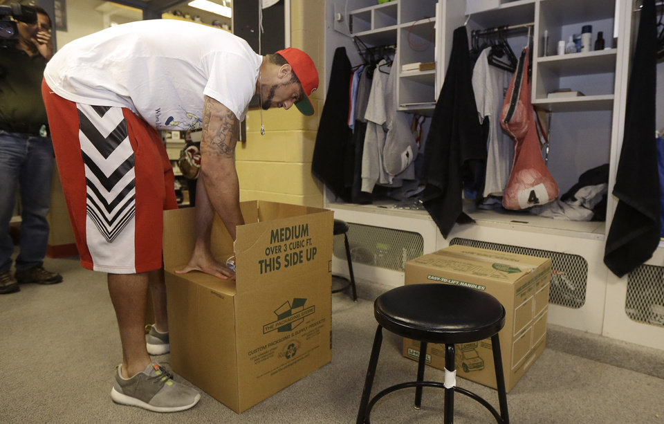 Photo - San Francisco 49ers quarterback Colin Kaepernick packs belongings from his locker at an NFL training facility in Santa Clara, Calif., Monday, Jan. 20, 2014. The 49ers lost to the Seattle Seahawks in the NFC Championship Game. (AP Photo/Jeff Chiu)