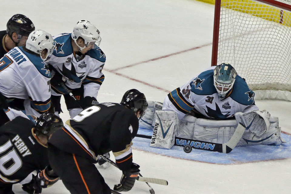 Photo - San Jose Sharks goalie Antti Niemi (31), of Finland, blocks a shot on goal by the Anaheim Ducks in the third period of an NHL hockey game in Anaheim, Calif., Monday, March 25, 2013. The Sharks won, 5-3. (AP Photo/Reed Saxon)