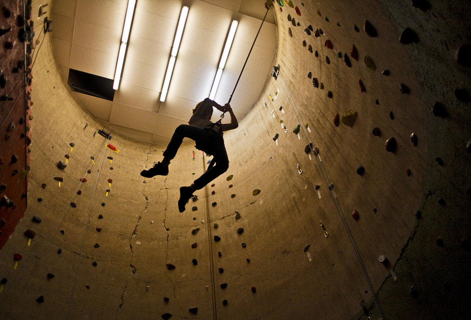 Jackson Slaton, 11, of Oklahoma City, is suspended in midair as he repels from the top of the wall inside the old grain towers at Rocktown Climbing Gym on Monday, Jan. 3, 2011, in Oklahoma City, Okla.  Photo by Chris Landsberger, The Oklahoman
