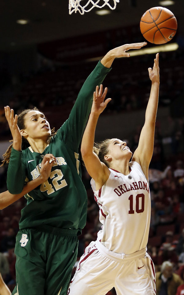 Photo - Oklahoma's Morgan Hook (10) takes a shot in front of Baylor's Brittney Griner (42) during a women's college basketball game between the University of Oklahoma and Baylor at the Lloyd Noble Center in Norman, Okla., Monday, Feb. 25, 2013. Baylor beat OU, 86-64. Photo by Nate Billings, The Oklahoman
