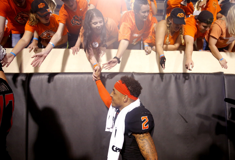 Photo - Oklahoma State's Tylan Wallace (2) high fives students following the college football game between the Oklahoma State Cowboys and the Kansas State Wildcats at Boone Pickens Stadium in Stillwater, Okla., Saturday, Sept. 28, 2019.  OSU won 26-13. [Sarah Phipps/The Oklahoman]