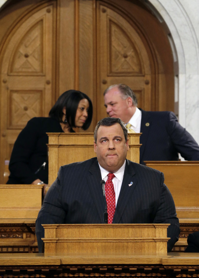 Photo - New Jersey Senate President Stephen M. Sweeney, right, D-Thorofare,N.J., and Assembly Speaker Sheila Y. Oliver, left, D-East Orange, N.J., talk as Gov. Chris Christie pauses while delivering his State Of The State address at the Statehouse, Tuesday, Jan. 8, 2013, in Trenton, N.J.  (AP Photo/Mel Evans)