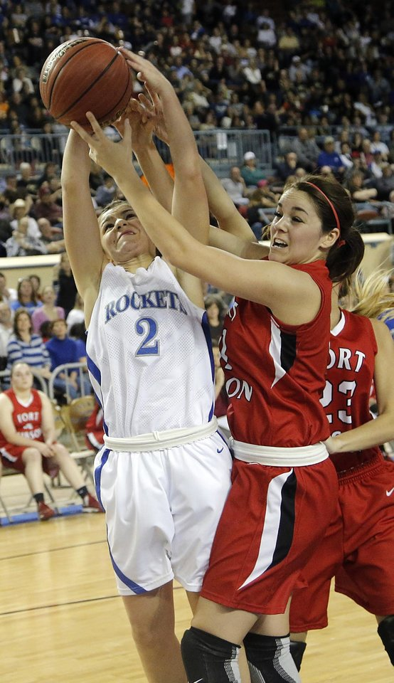 Mount Saint Mary's Aimee Rishcard (2) and Fort Gibson's Savannah Gray (11) battle for a rebound during the state high school basketball tournament Class 4A girls championship game between Fort Gibson High School and Mount St. Mary High School at the State Fair Arena on Saturday, March 9, 2013, in Oklahoma City, Okla. Photo by Chris Landsberger, The Oklahoman