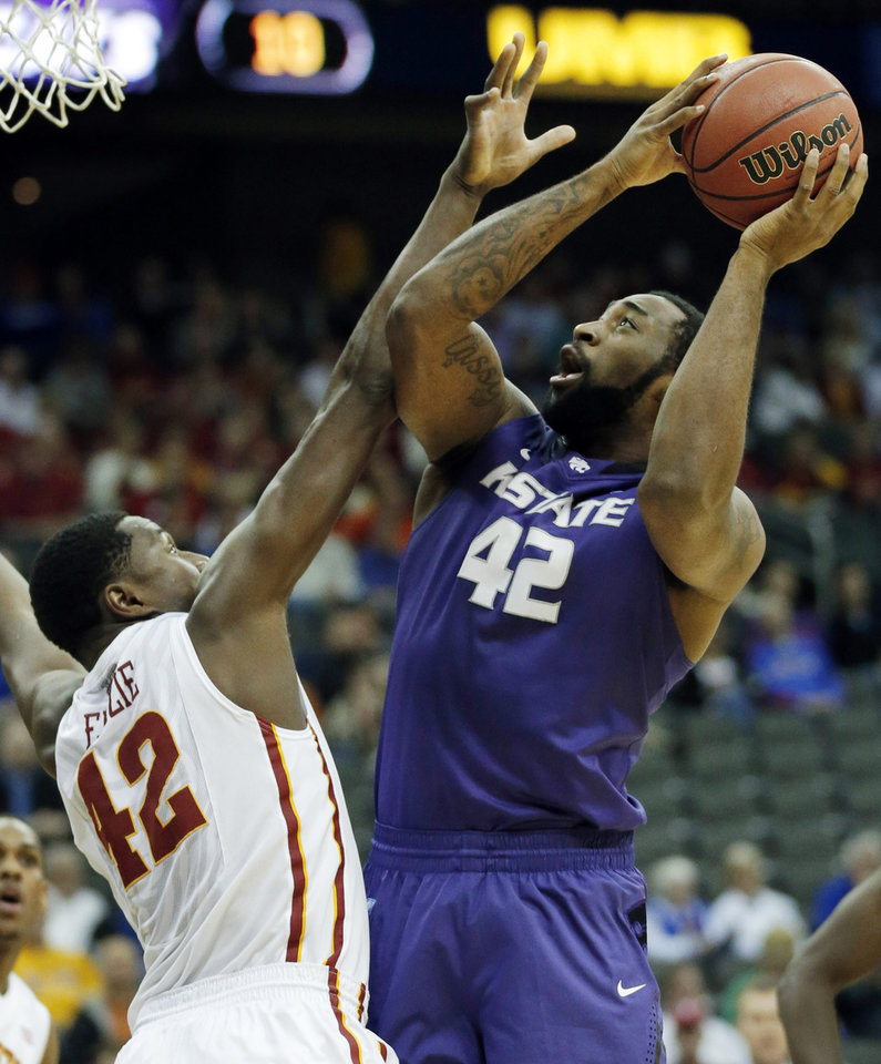 Photo - Kansas State forward Thomas Gipson, right, is fouled by Iowa State forward Daniel Edozie, left, during the first half of an NCAA college basketball game in the quarterfinals of the Big 12 Conference men's tournament in Kansas City, Mo., Thursday, March 13, 2014. (AP Photo/Orlin Wagner)