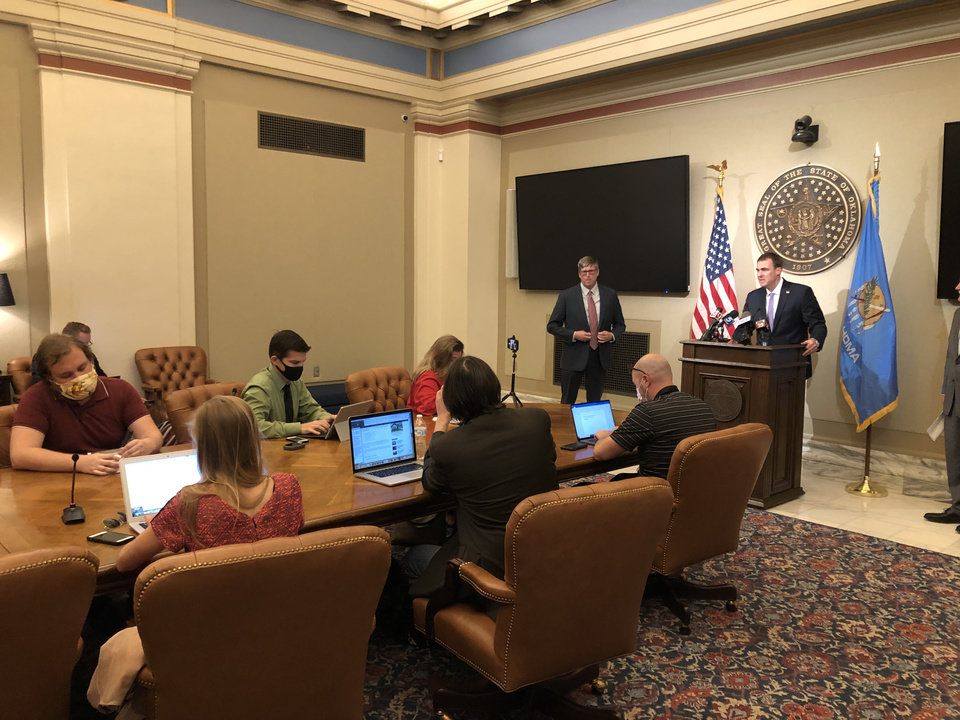 Photo - Gov. Stitt discusses the state's response to COVID-19 during a press conference Wednesday, May 20, 2020. [Dave Morris/The Oklahoman]