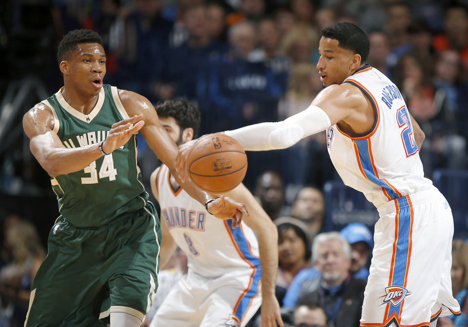 Photo - Oklahoma City's Andre Roberson (21) steals the ball from Milwaukee's Giannis Antetokounmpo (34) during an NBA basketball game between the Oklahoma City Thunder and the Milwaukee Bucks at Chesapeake Energy Arena in Oklahoma City, Tuesday, April 4, 2017. Photo by Bryan Terry, The Oklahoman