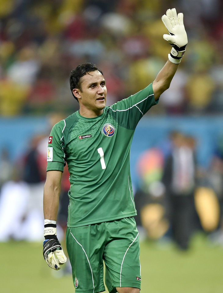 Photo - Costa Rica's goalkeeper Keylor Navas waves to supporters after Costa Rica defeated Greece 5-3 in penalty shootouts after a 1-1 tie during the World Cup round of 16 soccer match between Costa Rica and Greece at the Arena Pernambuco in Recife, Brazil, Sunday, June 29, 2014. (AP Photo/Martin Meissner)