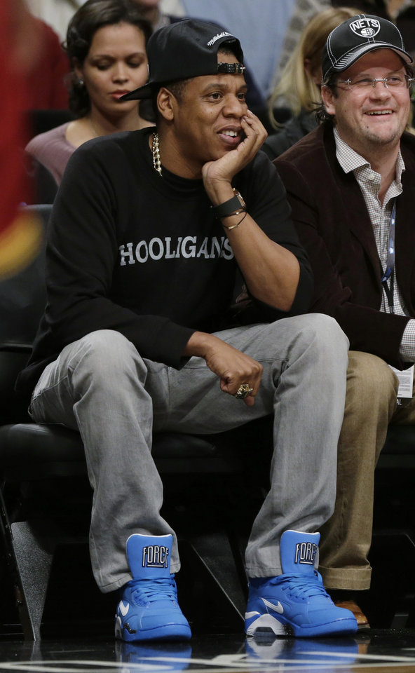 Jay-Z watches the first half of an NBA basketball game between the Brooklyn Nets and the Cleveland Cavaliers on Saturday, Dec. 29, 2012, in New York. (AP Photo/Frank Franklin II)