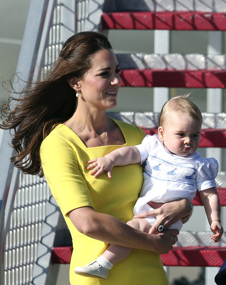 Photo - Britain's Kate, the Duchess of Cambridge, and Prince George arrive in Sydney,  Australia, Wednesday, April 16, 2014. The Duke and Duchess of Cambridge are on a three-week tour of Australia and New Zealand, the first official trip overseas with their son, Prince George. (AP Photo/Rob Griffith)