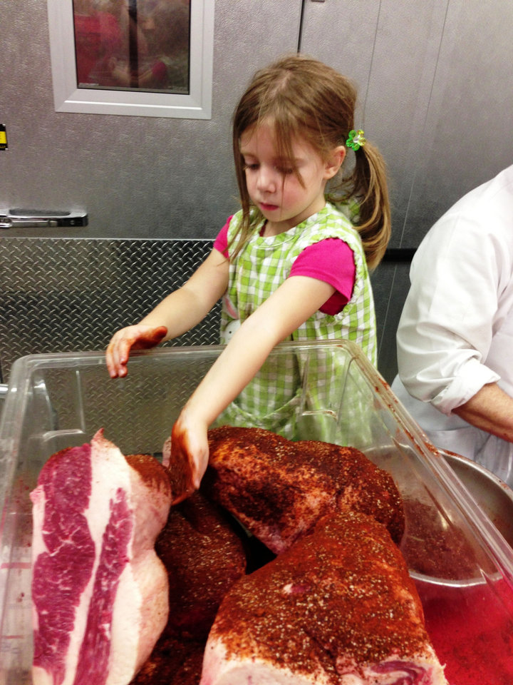 Photo - Olivia Dunham helps her dad chef Marc Dunham do prep on Saturday for the OK Chefs Relief Pop-Up Restaurant, which was Sunday and Monday in the Myriad Botanicals Gardens event space. All proceeds were donated to the Oklahoma Chapter of the American Red Cross.  DAVE CATHEY - THE OKLAHOMAN