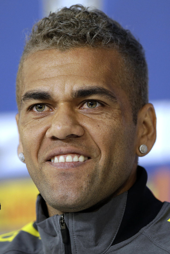 Photo - Brazil's Dani Alves looks on during a news conference at the Granja Comary training center in Teresopolis, Brazil, Saturday, June 21, 2014. Brazil plays in group A at the 2014 soccer World Cup. (AP Photo/Andre Penner)