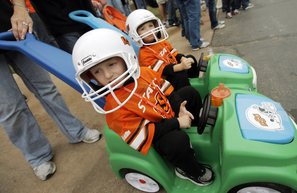 Photo - Cousins Damian Hance, left, and Noah Hance, both 3 years-old, wait for the start of the the Spirit Walk before the college football game between the Oklahoma State Cowboys (OSU) and the Nebraska Huskers (NU) at Boone Pickens Stadium in Stillwater, Okla., Saturday, Oct. 23, 2010. Photo by Nate Billings, The Oklahoman
