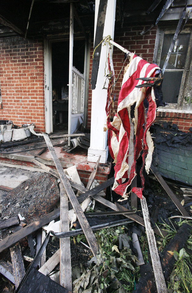 Burned American flag on the front porch of a fatal house fire at 2112 NW 20 Street in Oklahoma City Thursday, July 19, 2012. Photo by Paul B. Southerland, The Oklahoman