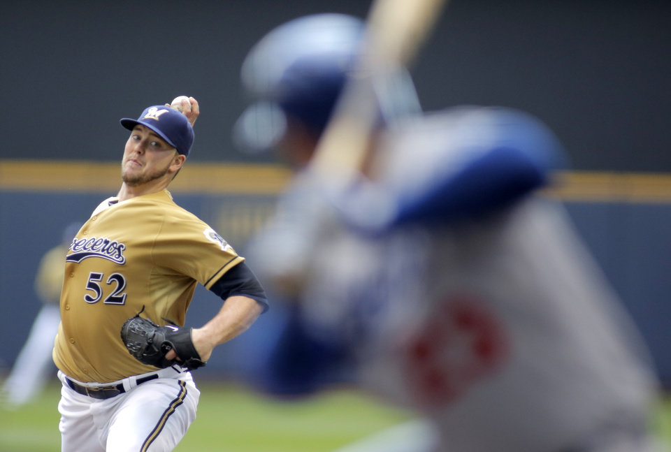 Photo - Milwaukee Brewers pitcher Jimmy Nelson delivers to the Los Angeles Dodgers during the first inning of a baseball game Sunday, Aug. 10, 2014, in Milwaukee. (AP Photo/Darren Hauck)