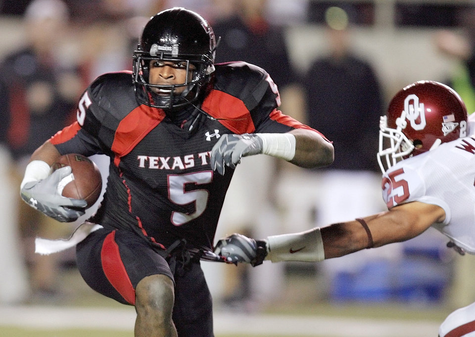 "Texas Tech�s uniforms (seen here worn by former Red Raider Michael Crabtree) were popular among Big 12 players, receiving 26 percent of the vote for ""best uniforms."" By Nate Billings, The Oklahoman Archive"