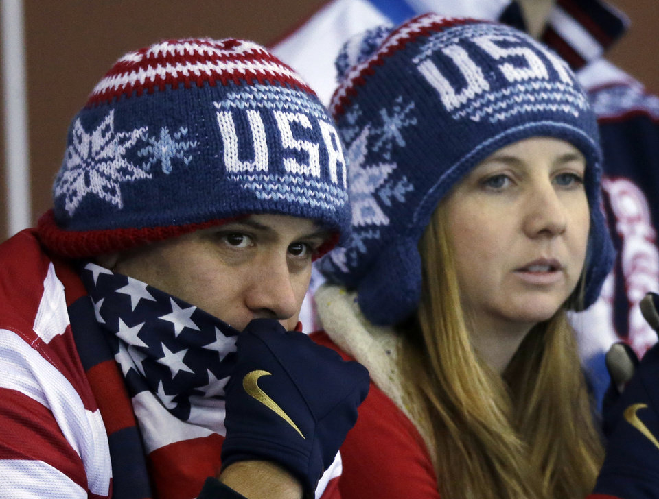 Photo - Some USA fans watch the round robin women's curling match between the United States and Denmark at the 2014 Winter Olympics, Friday, Feb. 14, 2014, in Sochi, Russia. (AP Photo/Morry Gash)